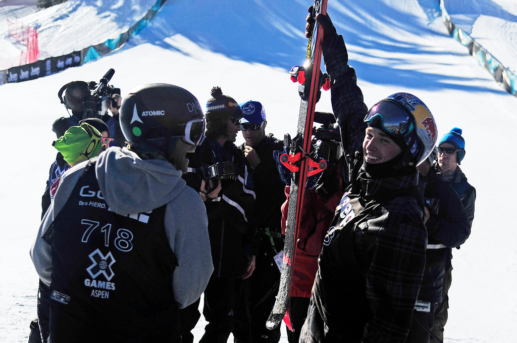. Nick Goepper raises his skis after winning gold at the men\'s ski slopestyle final in Aspen at Winter X Games in Aspen, January 26, 2014. (Photo By Mahala Gaylord/The Denver Post)
