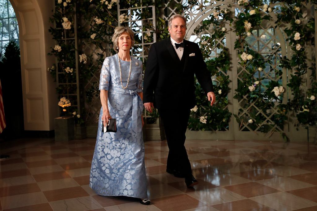 . Sarah Coulson and Dr. Douglas Bradburn arrive for a State Dinner with French President Emmanuel Macron and President Donald Trump at the White House, Tuesday, April 24, 2018, in Washington. (AP Photo/Alex Brandon)