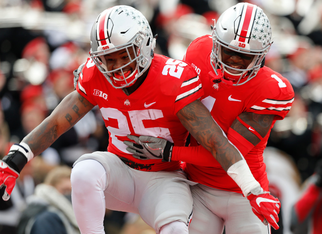 . Ohio State running back Mike Weber, left, celebrates his touchdown against Michigan State with teammate Johnnie Dixon during the first half of an NCAA college football game Saturday, Nov. 11, 2017, in Columbus, Ohio. (AP Photo/Jay LaPrete)