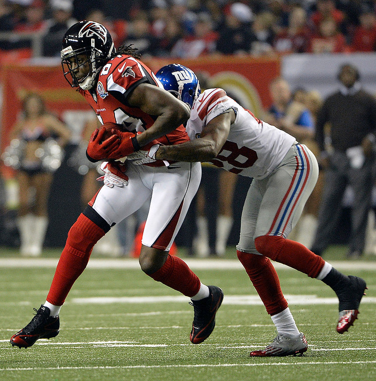 . Atlanta Falcons wide receiver Roddy White (84) runs against New York Giants cornerback Jayron Hosley (28) during the second half of an NFL football game on Sunday, Dec. 16, 2012, in Atlanta. (AP Photo/Rich Addicks)