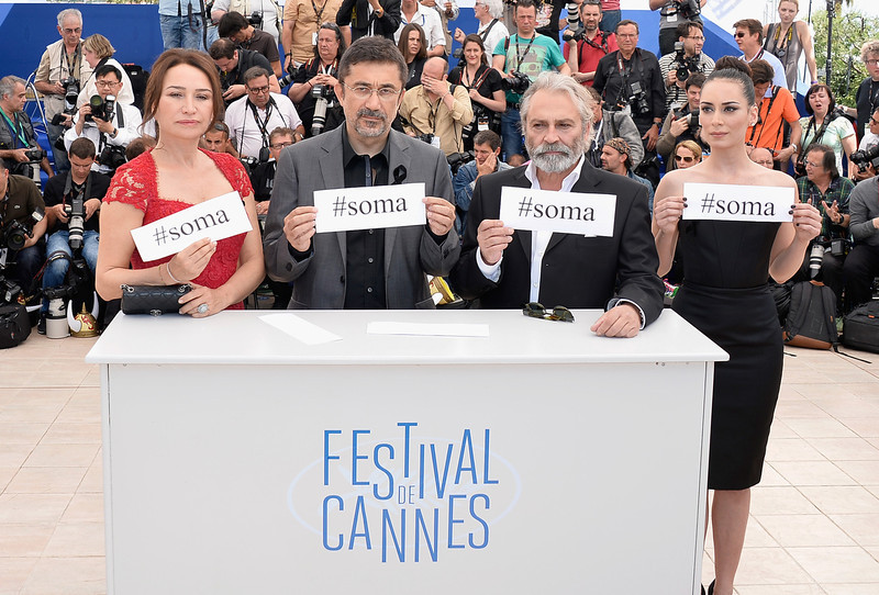 """. (L-R) Actress Demet Akbag, director Demet Akbag, actors Haluk Bilginer and Melisa Soezen attend the \""""Winter Sleep\"""" photocall at the 67th Annual Cannes Film Festival on May 16, 2014 in Cannes, France.  (Photo by Pascal Le Segretain/Getty Images)"""