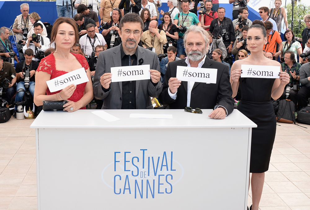 ". (L-R) Actress Demet Akbag, director Demet Akbag, actors Haluk Bilginer and Melisa Soezen attend the ""Winter Sleep\"" photocall at the 67th Annual Cannes Film Festival on May 16, 2014 in Cannes, France.  (Photo by Pascal Le Segretain/Getty Images)"