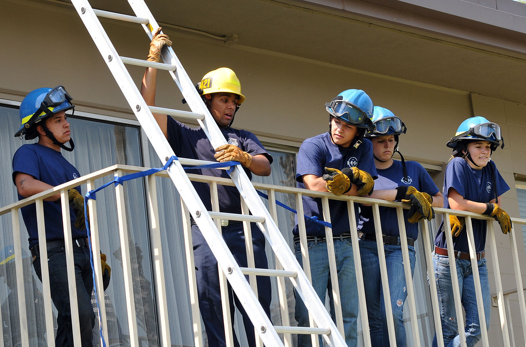 . (John Valenzuela/Staff Photographer) Firefighter Jesse Sparks gives instruction to Redlands Emergency Services Academy students during ladder training at the University of Redlands, Thursday, July 18, 2013.