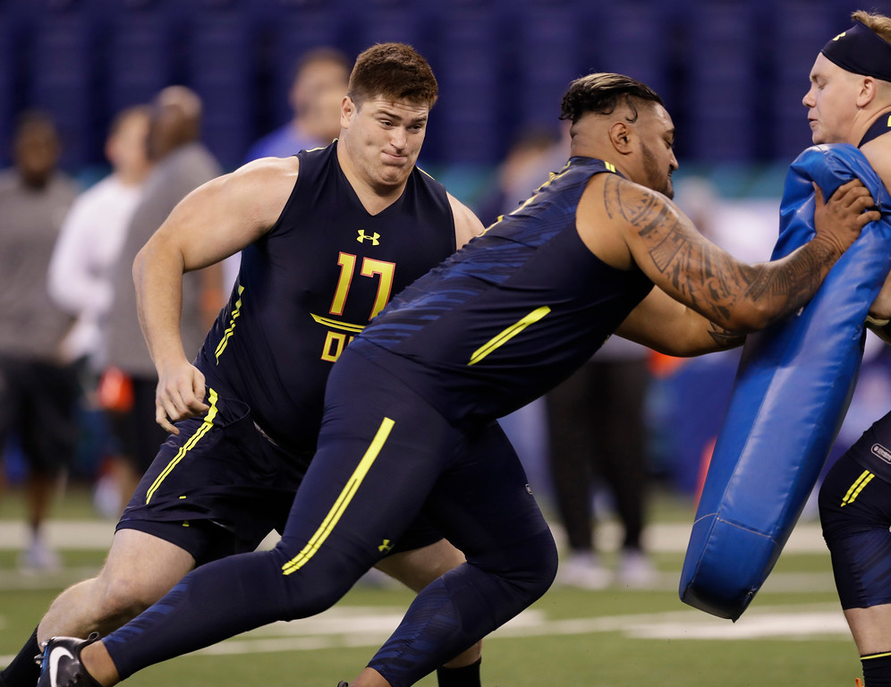 . Indiana offensive lineman Dan Feeney runs a drill at the NFL football scouting combine Friday, March 3, 2017, in Indianapolis. (AP Photo/David J. Phillip)