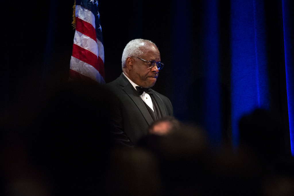 . Supreme Court Justice Clarence Thomas stands onstage after addressing the Federalist Society\'s National Lawyers Convention dinner at National Harbor, in Oxon Hill, MD, Thursday, Nov. 17, 2016. The convention is dedicated to the legacy of Supreme Court Associate Justice Antonin Scalia who died Feb 13, 2016. (AP Photo/Cliff Owen)