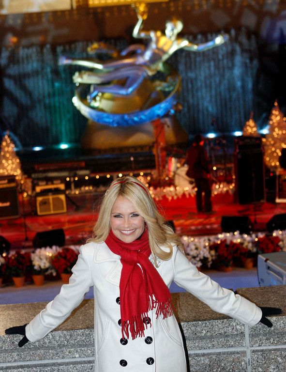 . Actress Kristin Chenoweth poses during the 76th annual Rockefeller Center Christmas tree lighting ceremony Wednesday, Dec. 3, 2008, in New York.  (AP Photo/Jason DeCrow)