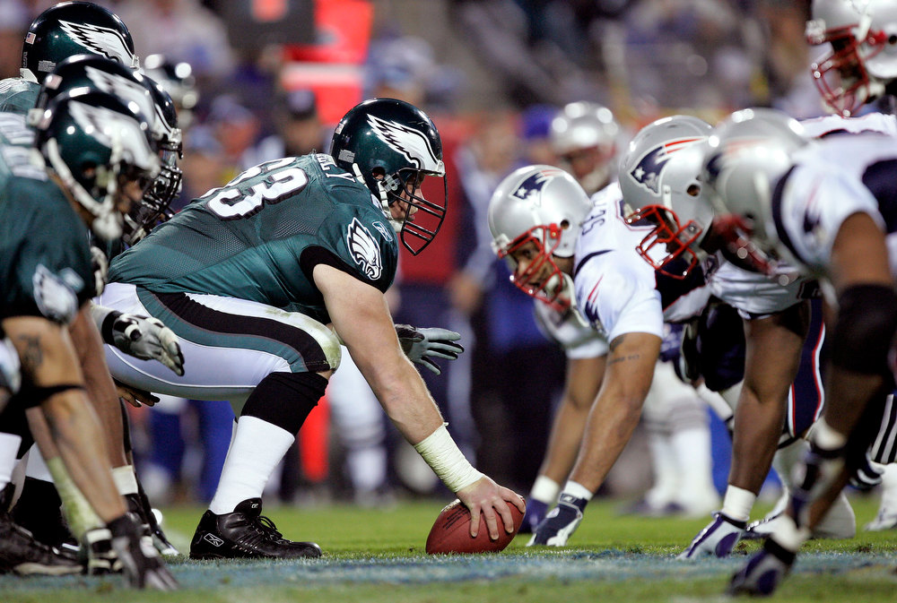 . Hank Fraley #63 of the Philadelphia Eagles prepares to snap against the New England Patriots in the fourth quarter of Super Bowl XXXIX at Alltel Stadium on February 6, 2005 in Jacksonville, Florida.  (Photo by Brian Bahr/Getty Images)