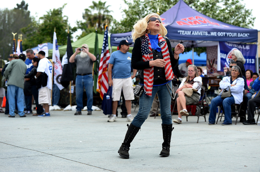 . A woman dances as Rock For Vets perform during Jose Ramos\' annual Welcome Home Vietnam Veterans Day at California High School in Whittier Saturday, April 13, 2013. Rock For Vets is a music therapy program out of the Long Beach VA. (SGVN/Staff Photo by Sarah Reingewirtz)