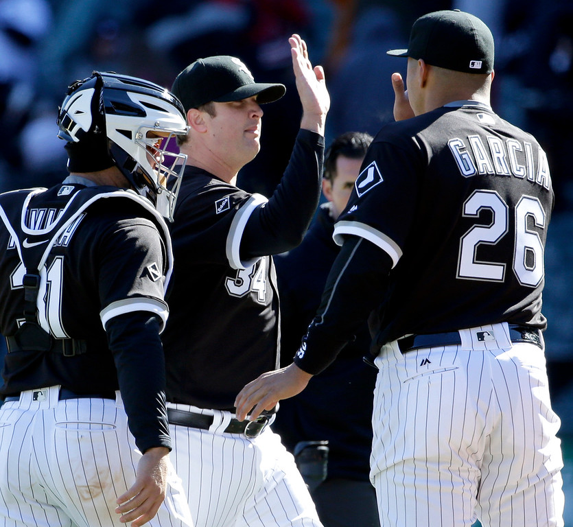 . Chicago White Sox relief pitcher Matt Albers, center, celebrates with Avisail Garcia, right, and catcher Alex Avila after they defeated the Cleveland Indians 7-3 in a baseball game Saturday, April 9, 2016, in Chicago. (AP Photo/Nam Y. Huh)