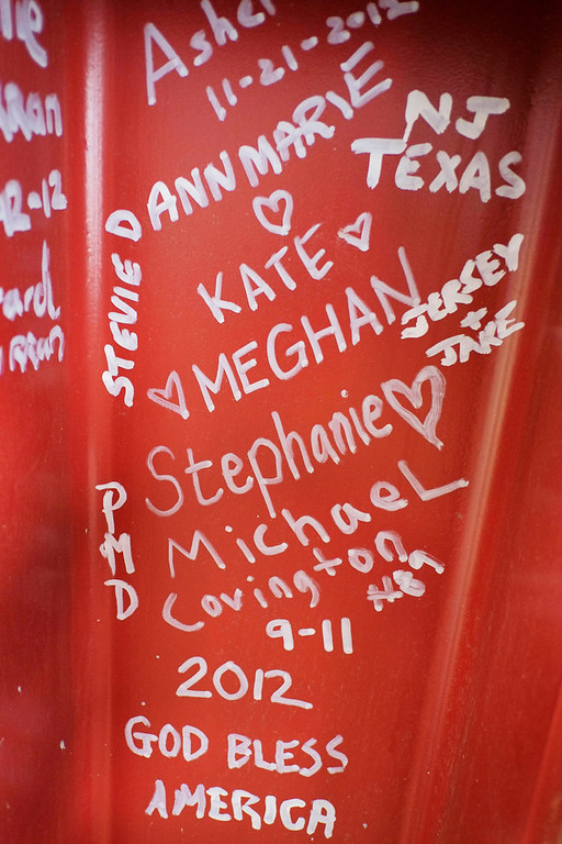 . This Jan. 15, 2013 photo shows graffiti left by visitors to the World Trade Center on a steel column on the 104th floor of One World Trade Center in New York. Construction workers finishing New York\'s tallest building at the World Trade Center are leaving their personal marks on the concrete and steel in the form of graffiti. (AP Photo/Mark Lennihan)