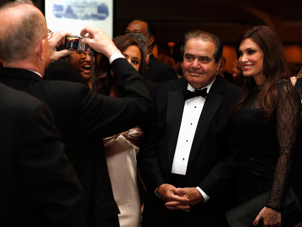 . U.S. Supreme Court Justice Antonin Scalia (2nd R) attends the White House Correspondents Association Dinner in Washington April 27, 2013. REUTERS/Kevin Lamarque