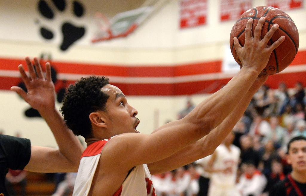 . Pasadena\'s Ajon Efferson drives to the basket against Ontario in the first half of a prep playoff game at Pasadena High School in Pasadena, Calif., on Friday, Feb.21, 2014. (Keith Birmingham Pasadena Star-News)