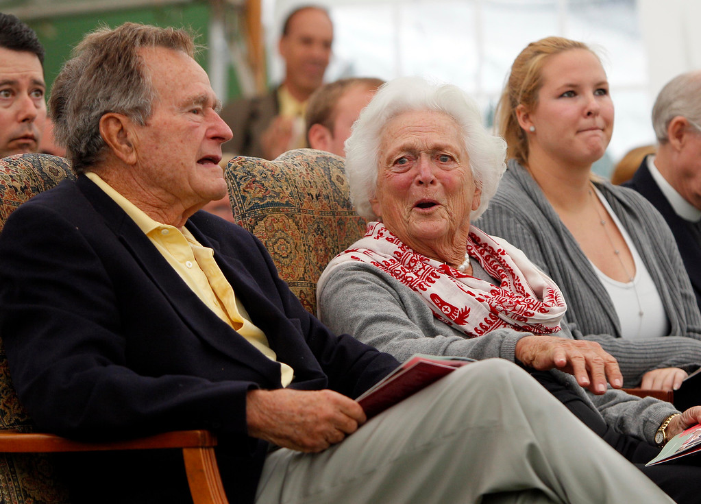 . Former President Goerge H. W. Bush and former first lady Barbara Bush chat at a ceremony to unveil a new garden named in Barbara\'s honor, Thursday, Sept 29, 2011, in Kennebunkport, Maine. A local group donated Ganny\'s Garden � Barbara Bush\'  grandchildren call her Ganny � on  the town green. It features flowers, greens and 17 trees in honor of the Bushes\' 17 grandchildren. (Photo by Robert F. Bukaty)