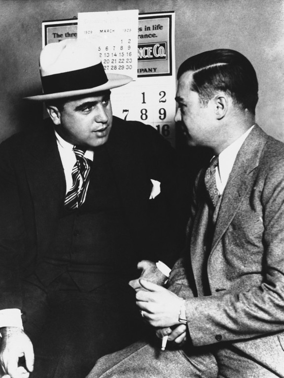 . Gangster Al Capone is shown at left, March 1924.  The other man is unidentified. (AP Photo)
