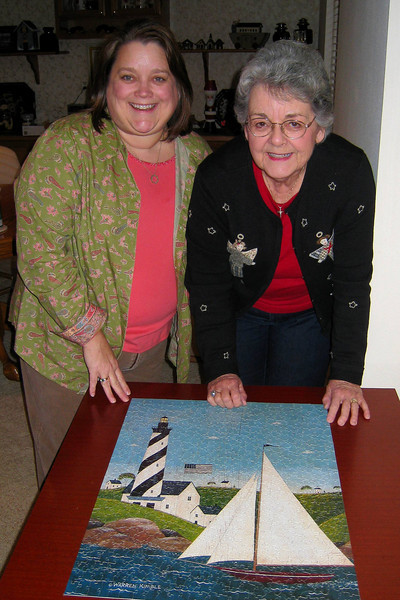 Christmas 2008 in CO - We decided to resurrect the family tradition of putting a puzzle together! Mom and Kathy showing the finished product. And Andy did the hard parts all by himself!!!