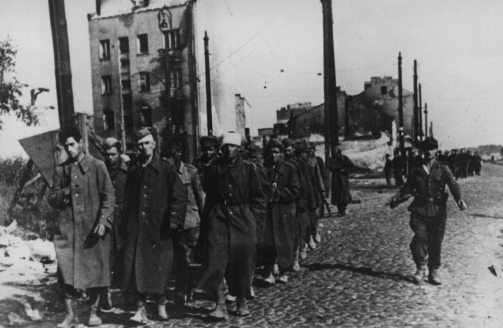 . 1st October 1944:  The end of Warsaw\'s uprising sees a group of city defenders marched off to prison camps by their German captors.  (Photo by Keystone/Getty Images)