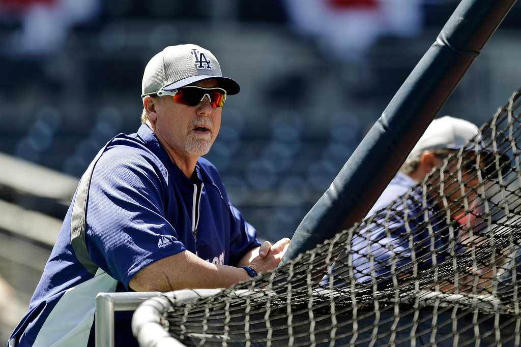 . Los Angeles Dodgers hitting coach Mark McGwire watches the team in the batting cage during warmups before a baseball game against the San Diego Padres in San Diego, Tuesday, April 9, 2013. (AP Photo/Lenny Ignelzi)