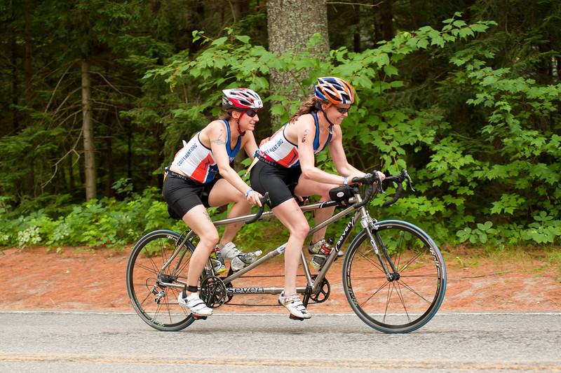 IronmanLP-51 - Approaching the top of Papa Bear Hill for the first time.  The woman stoking the tandem (back seat) is blind. I took this shot while waiting for Justin to come by on his second lap. She was a finisher!
