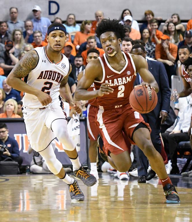 . Alabama guard Collin Sexton (2) brings a steal up the floor as Auburn guard Bryce Brown (2) follows during the second half of an NCAA college basketball game Wednesday, Feb. 21, 2018, in Auburn, Ala. Auburn won 90-71. (AP Photo/John Amis)