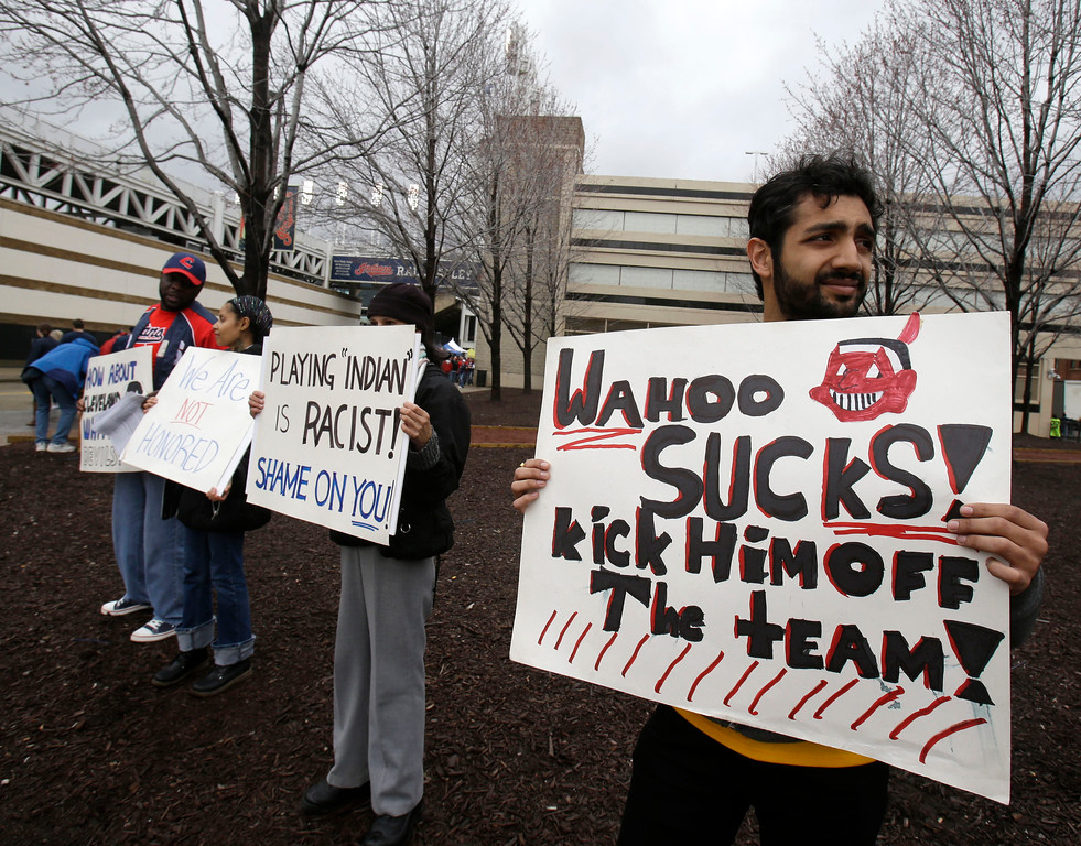 . Akshai Singh protests against the use of Chief Wahoo by the Cleveland Indians before a baseball game between the Minnesota Twins and the Cleveland Indians, Friday, April 4, 2014, in Cleveland. (AP Photo/Tony Dejak)