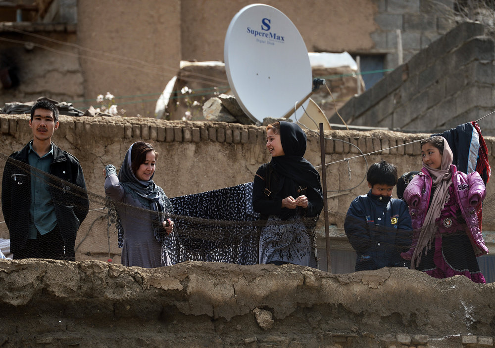 . Afghan families gather on top of a roof as they watch festivities near the Sakhi shrine, the centre of the Afghanistan new year celebrations in Kabul during Nowruz festivities on March 21, 2013. Nowruz, one of the biggest festivals of the war-scarred nation, marks the first day of spring and the beginning of the year in the Persian calendar. Nowruz is calculated according to a solar calendar, this coming year marking 1392. MASSOUD HOSSAINI/AFP/Getty Images