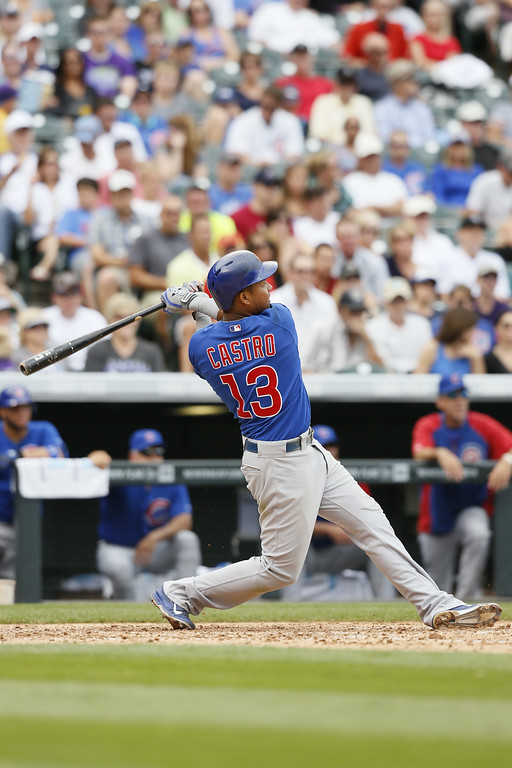 . Chicago Cubs shortstop Starlin Castro #13 hits a home run against the Colorado Rockies at Coors Field on August 7, 2014 in Denver, Colorado.  The Chicago Cubs defeated the Colorado Rockies 6-2.  (Photo by Trevor Brown, Jr./Getty Images)