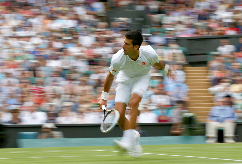 . Novak Djokovic of Serbia hits a return to Florian Mayer of Germany in their men\'s singles tennis match at the Wimbledon Tennis Championships, in London June 25, 2013.  REUTERS/Eddie Keogh