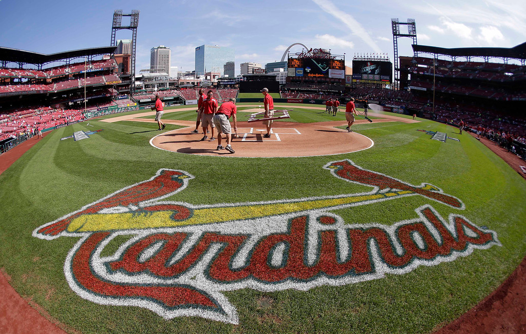 . In this image taken with a fisheye lens, the grounds crew prepares the field at Busch Stadium for Game 2 of baseball\'s National League division series between the St. Louis Cardinals and the Pittsburgh Pirates on Friday, Oct. 4, 2013, in St. Louis. (AP Photo/Charlie Riedel)