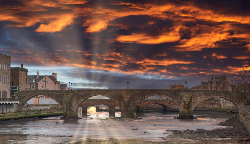 The Auld (Old) Brigg in Ayr in Scotland Dramatic Sunset over the Burn's Town