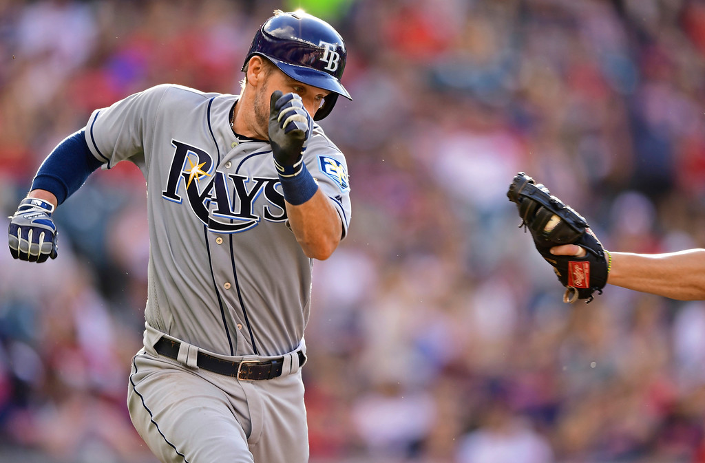. Tampa Bay Rays\' Adam Moore attempts to avoid being tagged by Cleveland Indians\' Yonder Alonso after a bunt during the seventh inning of a baseball game Sunday, Sept. 2, 2018, in Cleveland. The Rays won 6-4. (AP Photo/David Dermer)
