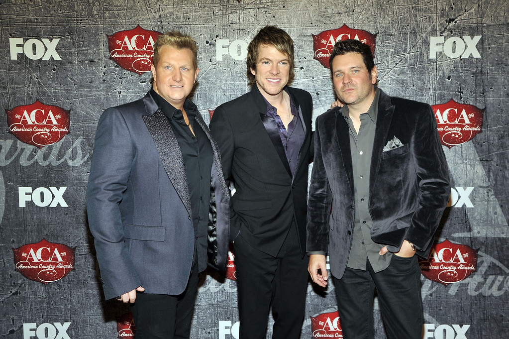 . From left, musicians Gary LeVox, Joe Don Rooney and Jay DeMarcus of Rascal Flatts arrive at the American Country Awards on Monday, Dec. 10, 2012, in Las Vegas. (Photo by Jeff Bottari/Invision/AP)