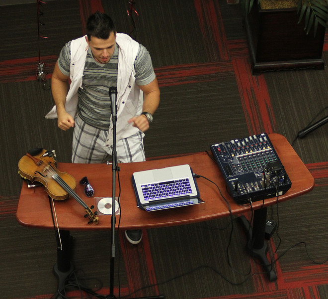 Bulgarian hip-hop violinist Svet dances during his performance for GWU in the Tucker Student Center on September 27.