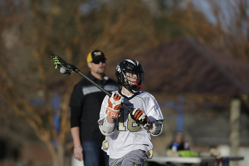 JPM0088-JPM0088-Jonathan first HS lacrosse game March 9th.jpg