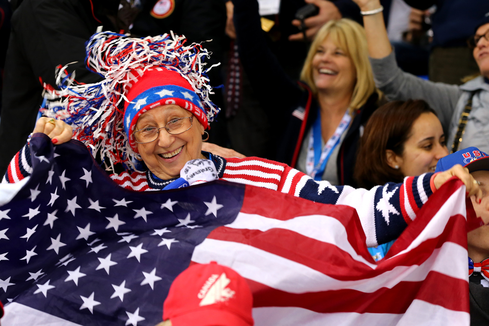 . SOCHI, RUSSIA - FEBRUARY 17: A United States  fan cheers in the crowd during the Women\'s Ice Hockey Playoffs Semifinal game against Sweden on day ten of the Sochi 2014 Winter Olympics at Shayba Arena on February 17, 2014 in Sochi, Russia.  (Photo by Martin Rose/Getty Images)