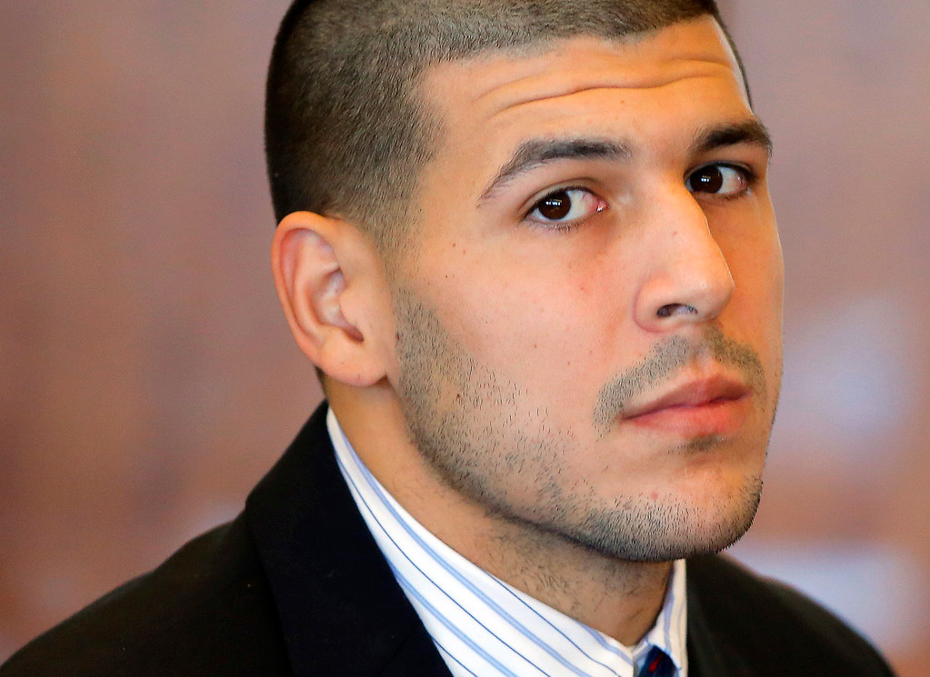 ". In this Oct. 9, 2013, file photo, former New England Patriots NFL football player Aaron Hernandez attends a pretrial court hearing in Fall River, Mass. Hernandez has pleaded not guilty to killing Odin Lloyd, 27, a semi-professional football player from Boston who was dating the sister of Hernandez\'s girlfriend. Police wrote in a June 28, 2013 search warrant application that there was probable cause to believe that Hernandez was driving a vehicle used in a separate double slaying of Daniel Jorge Correia de Abreu and Safiro Teixeira Furtado, in Boston, and ""may have been the shooter.\"" (AP Photo/Brian Snyder, Pool, File)"