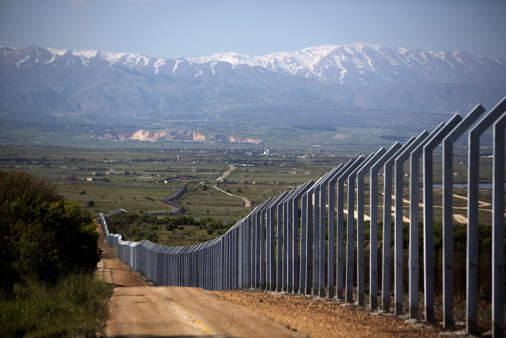 . The newly built Israeli border with Syria is seen on the Israeli side of the annexed Golan Heights near Quneitra on April 24 2013. Israel\'s Brigadier General Itai Brun, head of research and analysis in the army\'s military intelligence division, said that the Damascus regime was guilty of using chemical weapons against rebel fighters. MENAHEM KAHANA/AFP/Getty Images