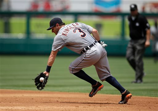 . Detroit Tigers second baseman Ian Kinsler fields a ball hit by Los Angeles Angels\' David Freese during the third inning of a baseball game on Sunday, July 27, 2014, in Anaheim, Calif. (AP Photo/Jae C. Hong)