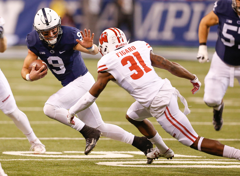 Penn State Nittany Lions quarterback Trace McSorley (9) tries to evade Wisconsin Badgers safety Lubern Figaro (31) during the first half of the Wisconsin Badgers against the Penn State Nittnay Lions for the Big Ten football championship at Lucas Oil Stadium in Indianapolis, Ind., Saturday, Dec. 3, 2016. (Photo by Sam Riche)