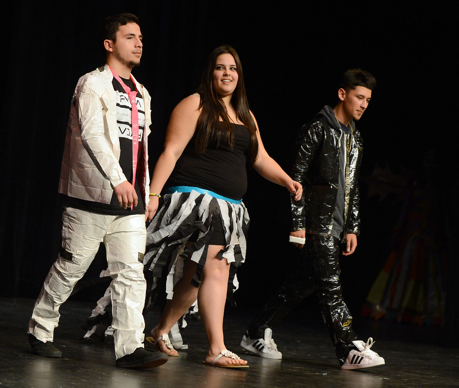 . From left, Daniel Guzman, Morgan Pengelly, and Christian Oregel model their creations at the third annual Paper Skirt Fashion Show held at Liberty High School in Brentwood, Calif.  on Tuesday, Jan. 29, 2013.   The young men made their suits out of duct tape. (Susan Tripp Pollard/Staff)
