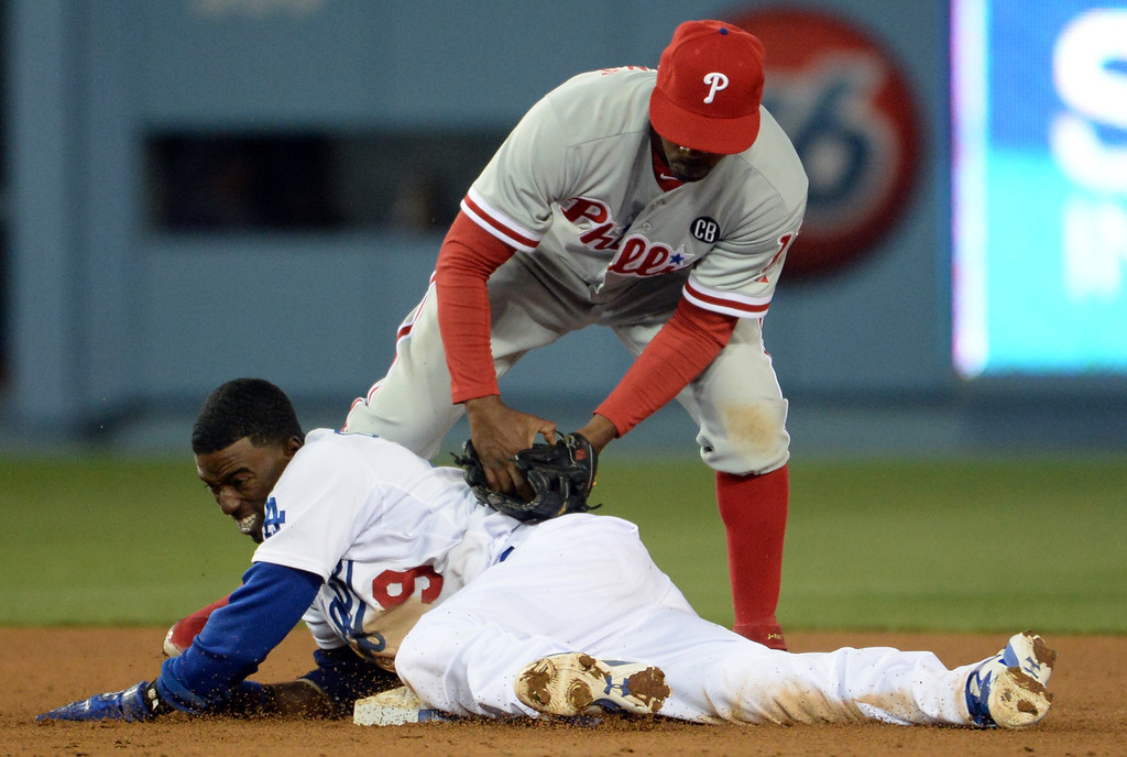 . Los Angeles Dodgers\' Dee Gordon safe at second base ahead of the tag by Philadelphia Phillies shortstop Jimmy Rollins in the seventh inning of a baseball game on Tuesday, April 22, 2013 in Los Angeles.   (Keith Birmingham/Pasadena Star-News)