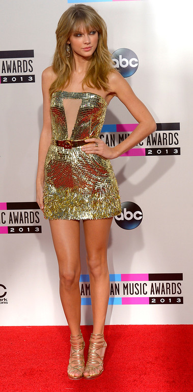 . Taylor Swift  arrives to the American Music Awards  at the Nokia Theatre in Los Angeles, California on Sunday November 24, 2013 (Photo by Andy Holzman / Los Angeles Daily News)