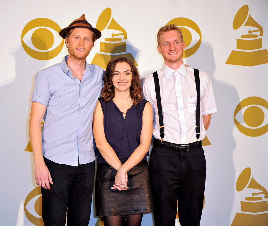 . The Lumineers, from left, Wesley Schultz, Neyla Pekarek and Jeremiah Fraites, pose for a photo backstage at the Grammy Nominations Concert Live! at Bridgestone Arena on Wednesday, Dec. 5, 2012, in Nashville, Tenn. (Photo by Donn Jones/Invision/AP)