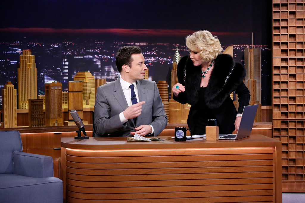 """. In this photo provided by NBC, Jimmy Fallon appears with Joan Rivers, right, during his \""""The Tonight Show\"""" debut on Monday, Feb. 17, 2014, in New York. Fallon departed from the network\'s �Late Night� on Feb. 7, 2014, after five years as host, and is now the host of �The Tonight Show.� Rivers appeared on the show after 49 years earlier to the day, the veteran comedian had made her first appearance on \""""The Tonight Show Starring Johnny Carson\"""" in that very studio, and had not appeared on \""""Tonight\"""" since 1987, when she was banned by Carson after jumping to Fox to host her own short-lived show. (AP Photo/NBC, Lloyd Bishop)"""