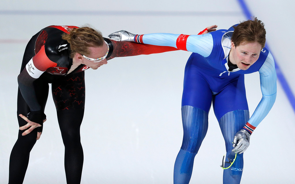 . Silver medallist Ted-Jan Bloemen of Canada, left, and bronze medallist Norway\'s Sverre Lunde Pedersen, right, hug after competing during the men\'s 5,000 meters race at the Gangneung Oval at the 2018 Winter Olympics in Gangneung, South Korea, Sunday, Feb. 11, 2018. (AP Photo/John Locher)