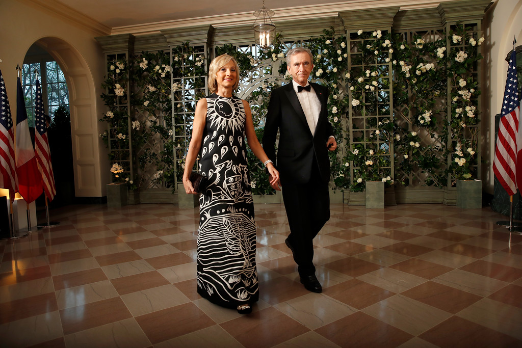 . Bernard Arnault and Helene Arnault arrive for a State Dinner with French President Emmanuel Macron and President Donald Trump at the White House, Tuesday, April 24, 2018, in Washington. (AP Photo/Alex Brandon)