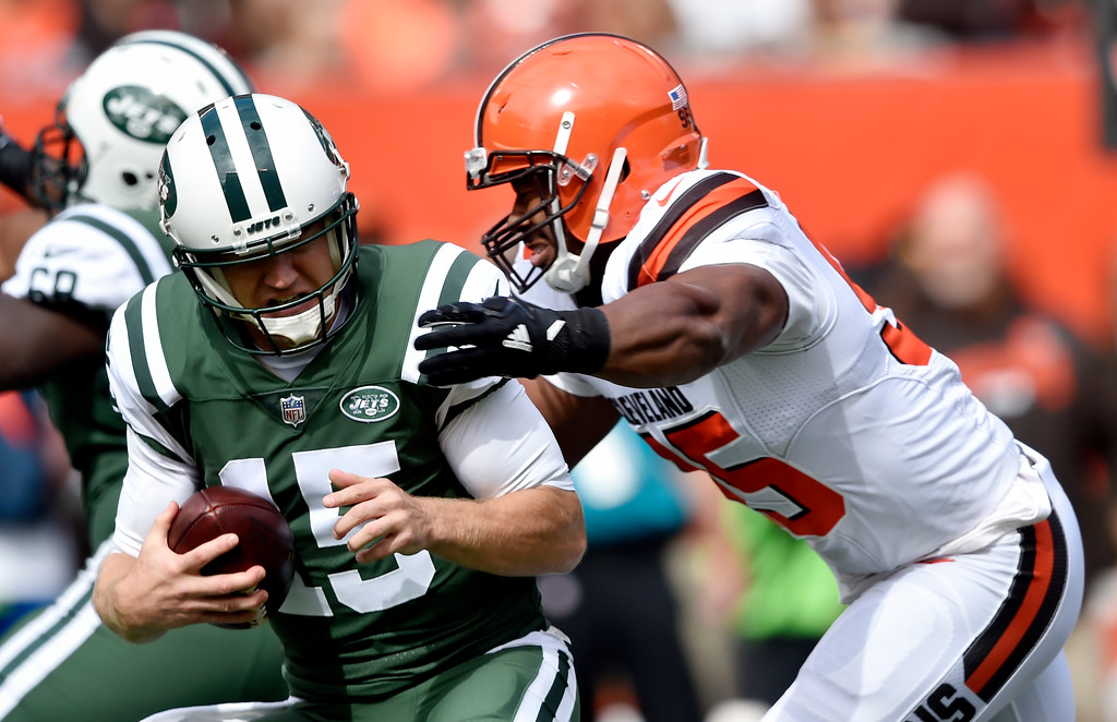 . Cleveland Browns defensive end Myles Garrett, right, sacks New York Jets quarterback Josh McCown during the first half of an NFL football game, Sunday, Oct. 8, 2017, in Cleveland. (AP Photo/David Richard)