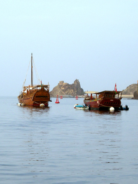 dhows in the harbor in Muscat, Oman