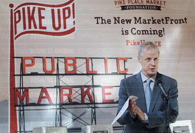 Seattle business and civic leaders speak about the Pike Place Marketfront project during event in Seattle, Washington