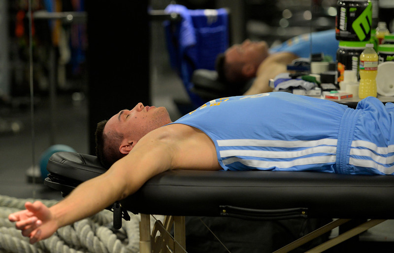 . Denver Nuggets Danilo Gallinari relaxes as assistant coach/strength and conditioning Steve Hess works on him before his workout in the training room, May 27, 2014 at Pepsi Center. (Photo by John Leyba/The Denver Post)