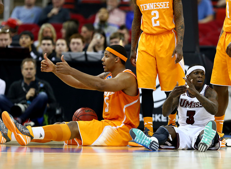 . Jarnell Stokes #5 of the Tennessee Volunteers attempts to call a jump ball as Chaz Williams #3 of the Massachusetts Minutemen tries to call a time out in the second half in the second round of the 2014 NCAA Men\'s Basketball Tournament at PNC Arena on March 21, 2014 in Raleigh, North Carolina.  (Photo by Streeter Lecka/Getty Images)